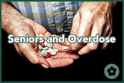 Heap of colorful medical pills in senior male hands closeup.